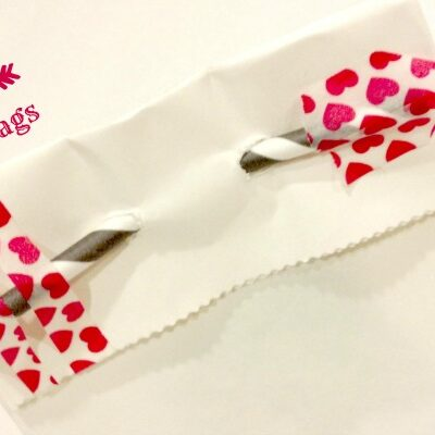 Craft a cute arrow with washi tape and a straw to make these adorable Shot Through the Heart Treat Bags { anightowlblog.com } #valentines #washi