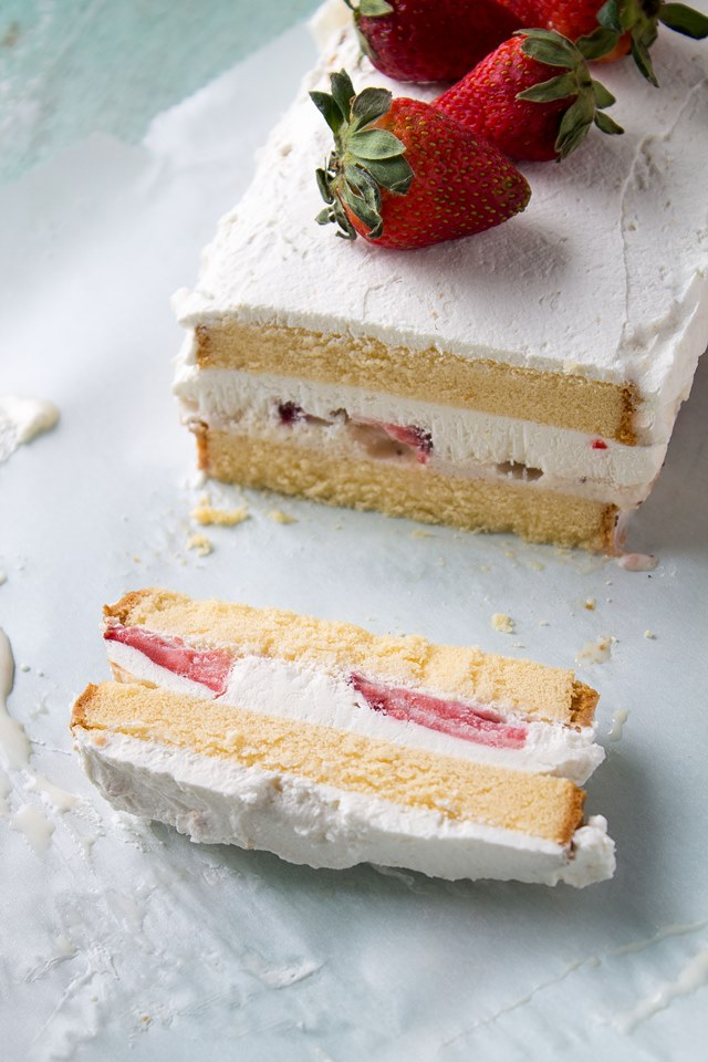 Layers of pound cake, strawberries, and ice cream make this a decadent and creamy Strawberries and Cream Ice Cream Cake!