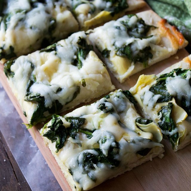 Spinach and Artichoke Dip Pizza - homemade pizza crust topped with spinach, cream cheese, and artichokes.