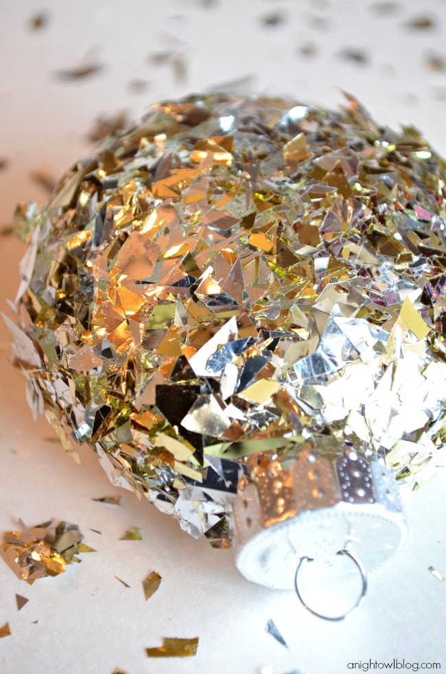Make your own sparkly and fabulous ornaments with a little confetti and decoupage!
