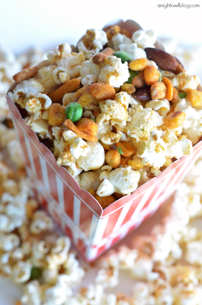 Gourmet Popcorn Recipes like this Spicy Cajun Popcorn are the perfect addition to movie night! Pick up all the supplies you need at World Market!