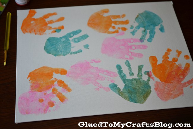 Handprint Mother's Day Kids Canvas - an adorable craft your kids can do in just a few easy steps!