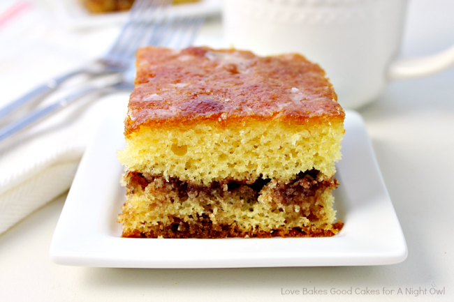 This Honey Bun Cake is reminiscent of the snack cake! A yellow cake mix is doctored up with a few ingredients, including a delicious cinnamon-nut layer!