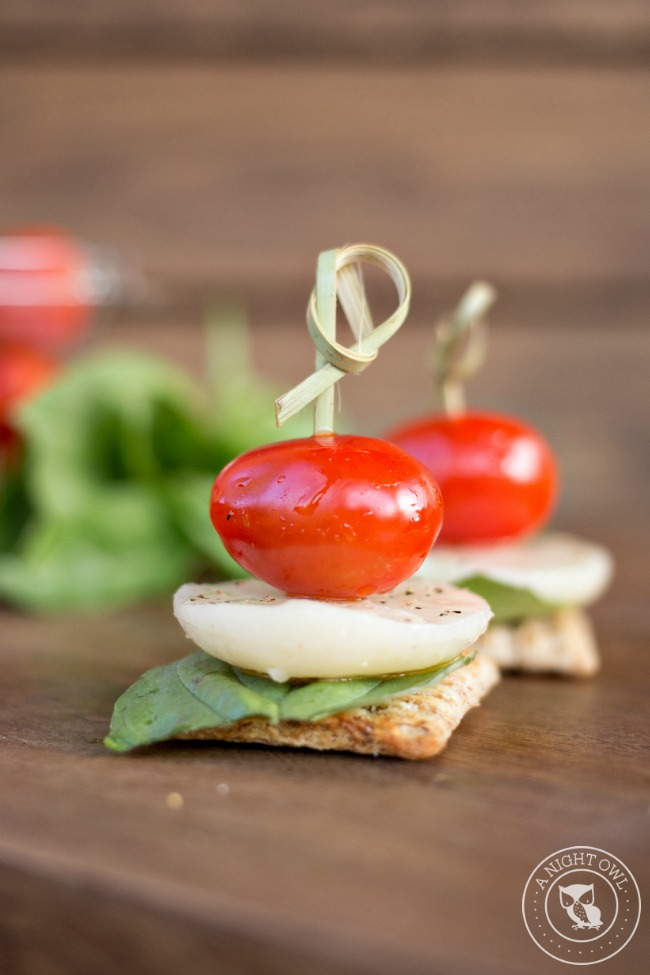 Caprese Triscuit Snacks - mozzarella, basil and tomato stacked up high on your favorite Triscuit cracker! The perfect snack!