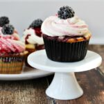 Blackberry Vanilla Swirl Cupcakes - vanilla cupcakes swirled with blackberry and porter compote, topped with decadent blackberry swirl frosting!