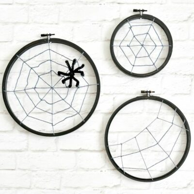 These Spooky Spider Web Hoops are adorable and easy to make with craft supplies you might just have on hand!