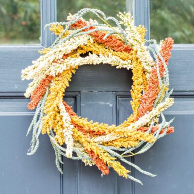 This Easy DIY Fall Wreath brings some festive decor to your home, and can also serve as an amazing hostess gift!