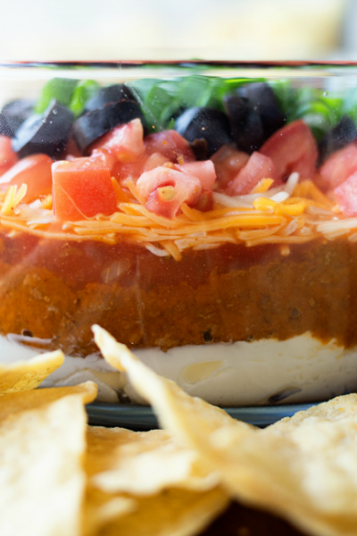 A fun twist on the classic dish, this Chili Cheese 7 Layer Dip is easy to whip up and a real crowd-pleaser!
