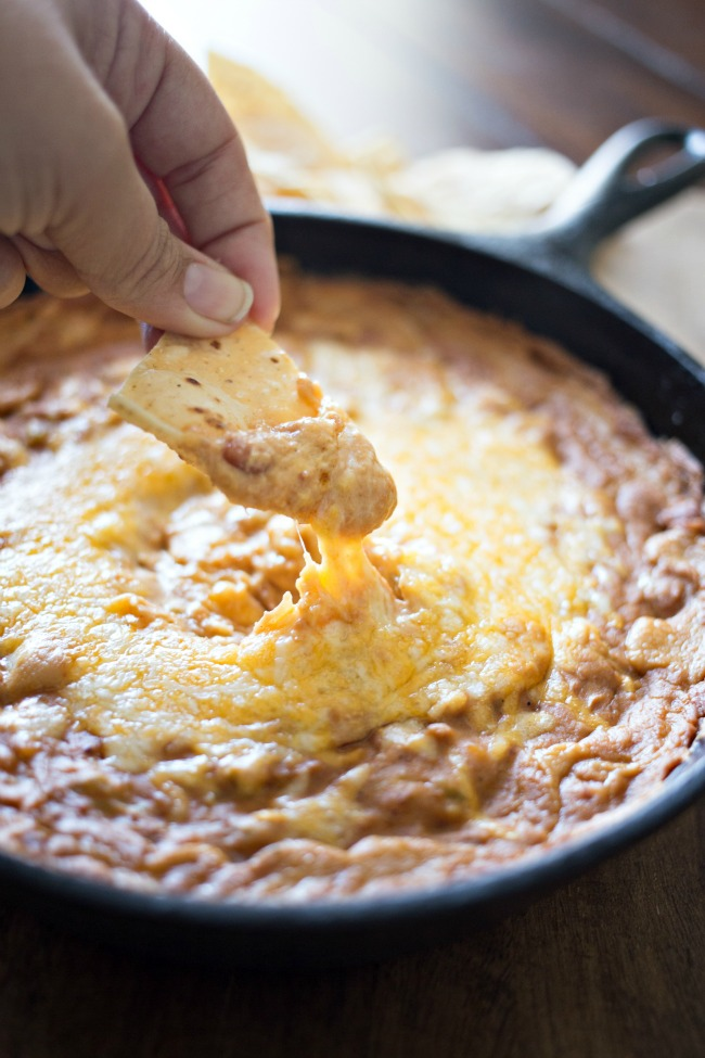 Whip up this easy and delicious Green Chile Bean Dip in one skillet and serve!