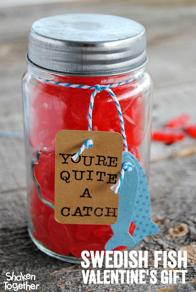 "Let your guy know he is ""quite a catch"" with this easy, adorable Swedish Fish Valentine's Gift complete with a hand stamped tag and stringer of paper fish!"