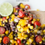 All the flavors of the Southwest in one zesty Black Bean Salsa Salad! Perfect for summer parties, this simple salad will be a hit!
