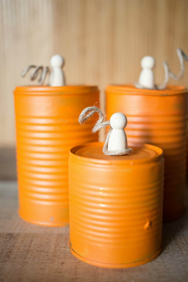 Paint left over tin cans orange and top with knobs and twine for adorable and thrifty chic fall decor!