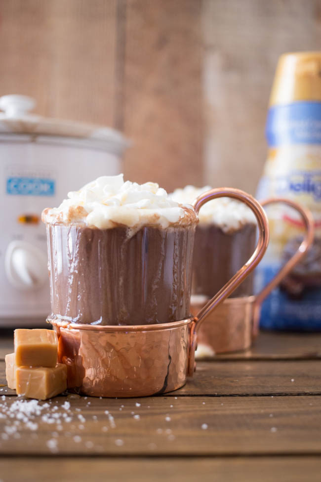 This Crock Pot Salted Caramel Hot Chocolate is just three ingredients and is so easy to make! Perfect for a chilly fall or winter evening!