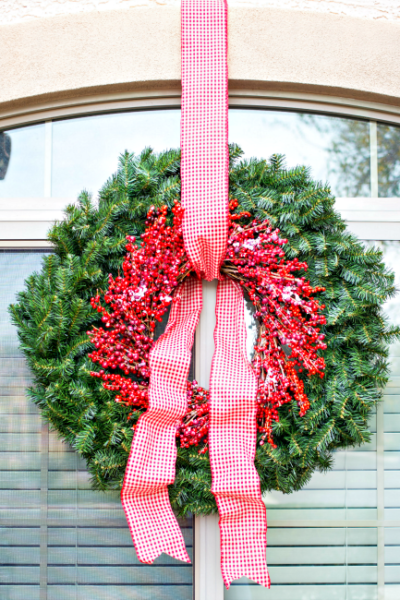 """Make a beautiful, large statement wreath for your home with this easy """"hack!"""""""