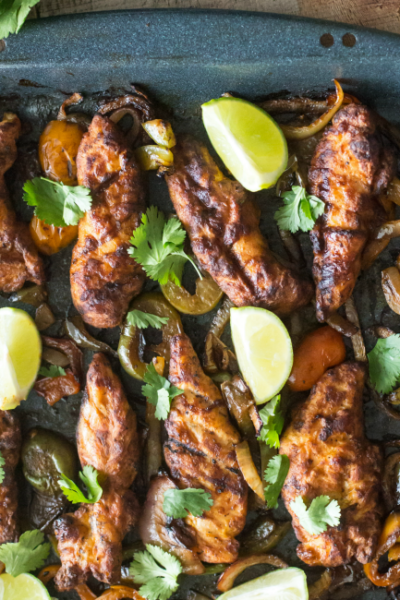 These Fire Grilled Sheet Pan Fajitas are packed full of flavor and are ready in just 20 minutes!