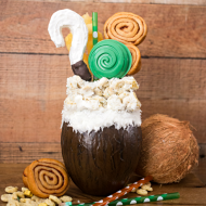 If you like Pina Coladas...you'll love this Disney inspired Moana Pina Colada Freak Shake! A delicious tropical shake topped with Moana inspired treats.