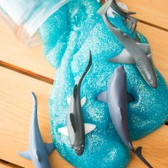 Perfect for summer play, #SharkWeek or any day of the year - whip up this 3-ingredient DIY Shark Slime that is safe and easy enough for your kids to make!