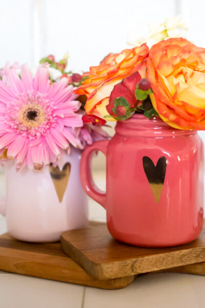 Perfect for a sweet Valentine's Day gift for friends, teachers, neighbors and more - create Valentine's Day Mason Jar Bouquets withSafeway's exclusive debi lilly design™ collection!