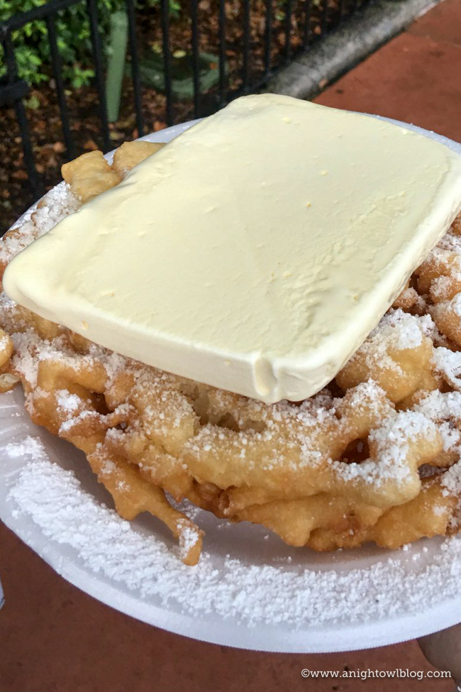Guide to Eating Around the World at EPCOT: Funnel Cake with Vanilla Ice Cream at Epcot World Showcase #EPCOT #WaltDisneyWorld