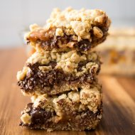 Stuffed with Werther's Soft Caramels, peanuts and chocolate chips, you're going to drool over these Stuffed Caramel Chocolate Chip Cookie Bars! #chocol