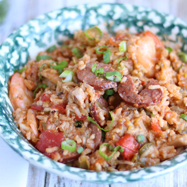 Made with chicken, sausage, shrimp and vegetables, this Instant Pot Jambalaya is a quick and hearty pressure cooker meal your family will love!