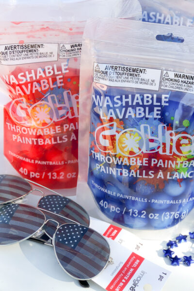 Perfect for a fun, 4th of July outdoor party idea, throw a Patriotic Goblies Paintball Party with Goblies Throwable Paintballs & Power Paint Shot, available Nationwide at Michaels Stores