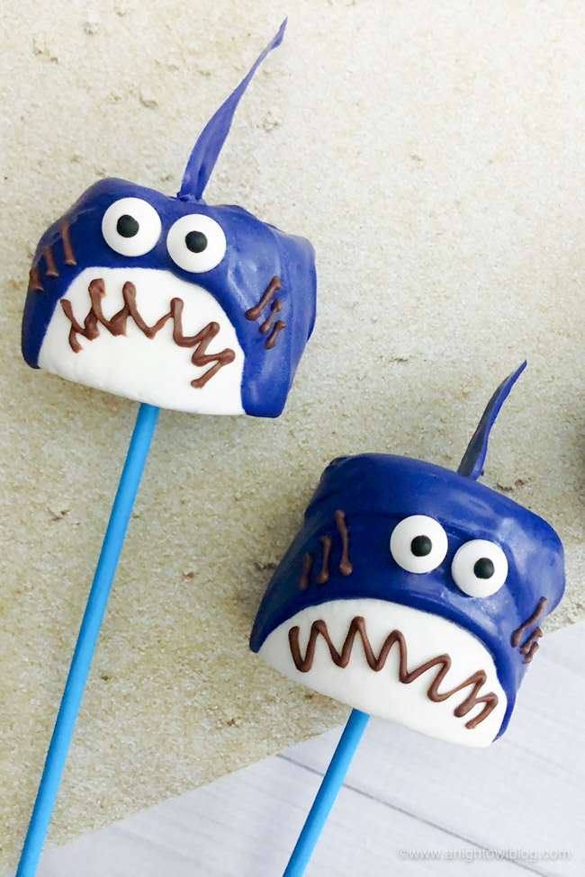 These Shark Marshmallow Pops are easy, tasty and fun! The perfect #SharkWeek or shark party treat for the kids or shark lover in your life!