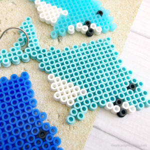 This Shark Perler Bead Pattern to make Shark Keychains is the perfect kid or shark lover activity for #SharkWeek, a Shark Party and more!