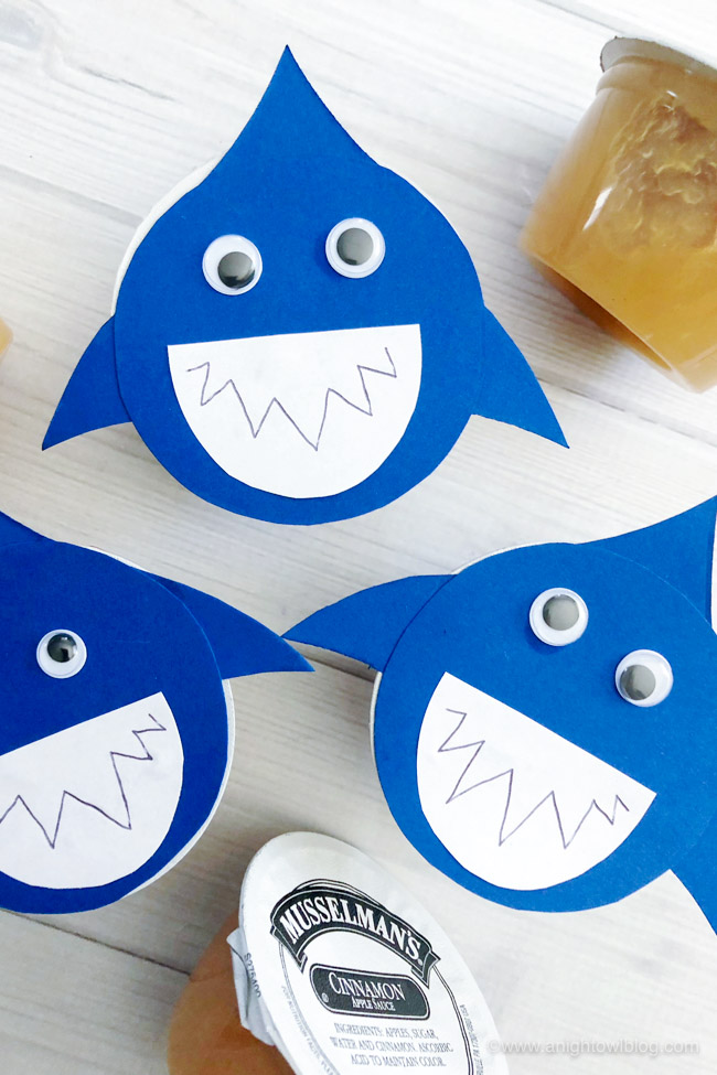 TheseShark Snack Cups made with applesauce cups or perfect for pudding cups too,are the perfect #SharkWeek or shark party treat for the kids or shark lover in your life!