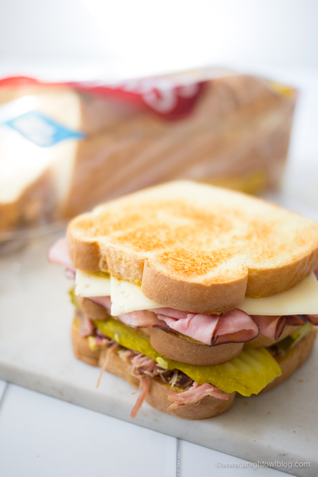 This Easy Cuban Club Sandwich is made with ham, pulled pork, Swiss cheese, pickles, mustard and Sara Lee Butter Bread for a sandwich that is hearty and full of flavor!