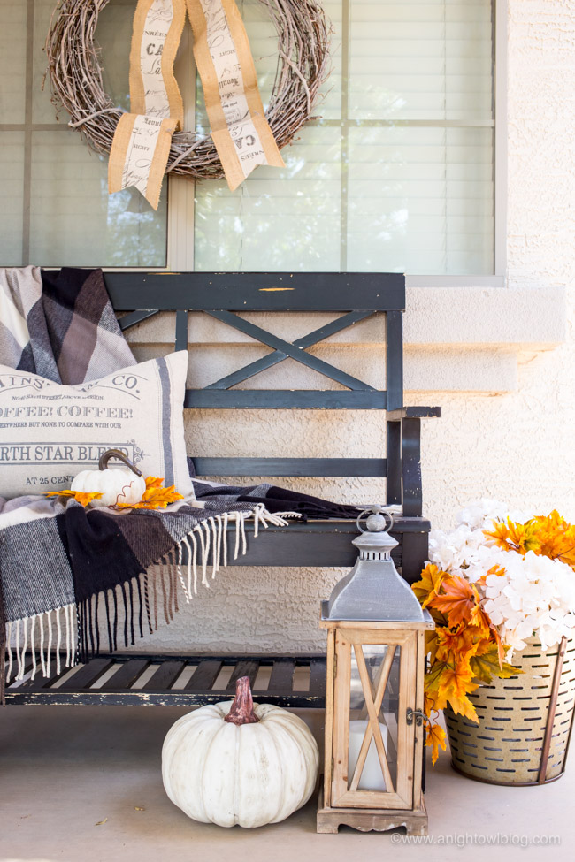This year, create a Fall Farmhouse Porch with warm and cozy design elements, full of charm and character