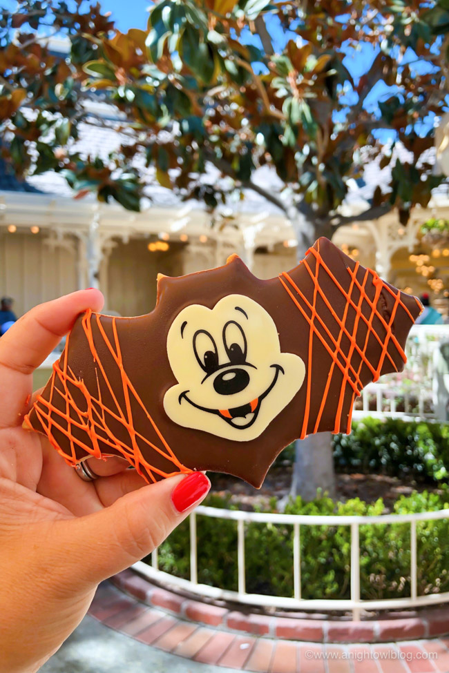 Halloween Mickey Bat Cookie from Jolly Holiday | From the Mickey Mummy Macaron to the Bat Wing Raspberry Sundae, check out our picks for The BEST Disneyland Halloween Treats! #Disneyland #HalloweenTime