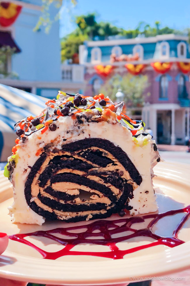 Halloween Chocolate Hazelnut Yule Log from Plaza Inn Cafe | From the Mickey Mummy Macaron to the Bat Wing Raspberry Sundae, check out our picks for The BEST Disneyland Halloween Treats! #Disneyland #HalloweenTime