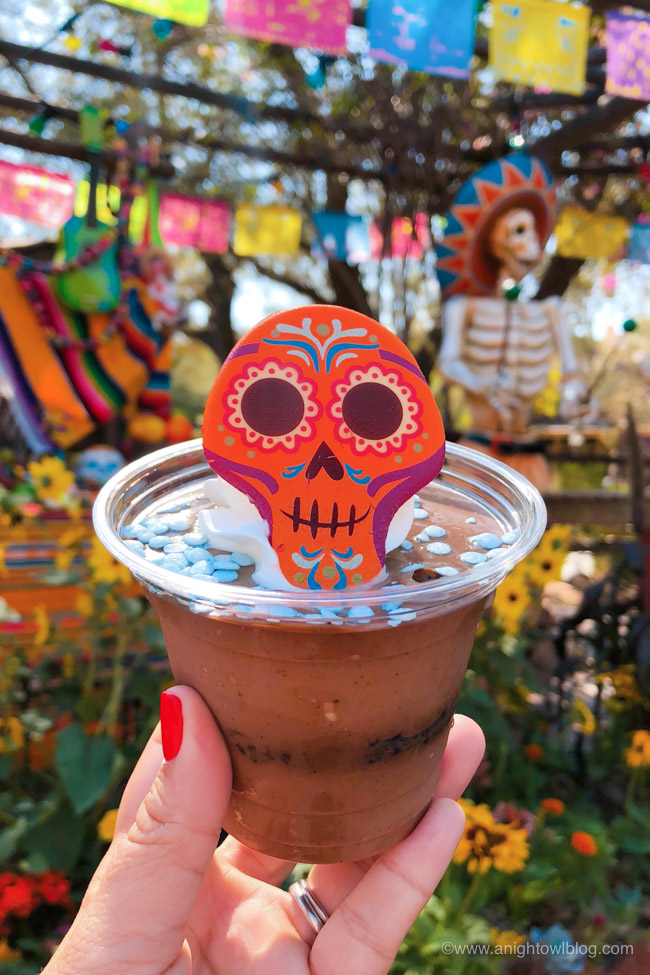 Orange Sugar Skull Pot de Crème from Rancho del Zocalo | From the Mickey Mummy Macaron to the Bat Wing Raspberry Sundae, check out our picks for The BEST Disneyland Halloween Treats! #Disneyland #HalloweenTime