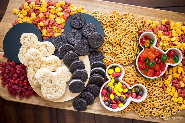 This Mickey Mouse Themed Snack Board is full of Mickey treats that are perfect for Mickey's birthday or your Disney themed party or movie night.