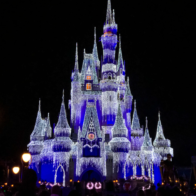 Cinderella's Castle | The after hours event is full of live entertainment and holiday cheer. Here are some great Mickey's Very Merry Christmas party tips.
