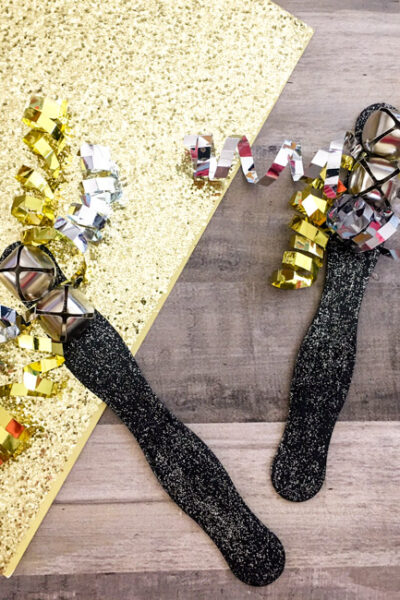 A perfect craft for kids leading up to New Year's, create your very own DIY New Year's Eve Noise Makers to ring in the New Year in DIY style!