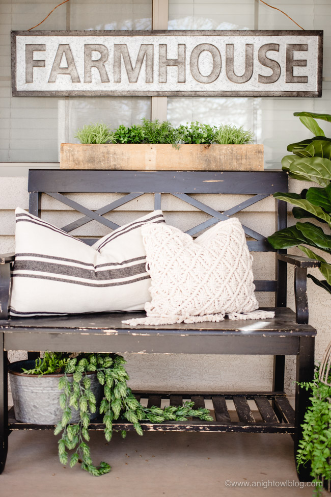 This year, create an easy Spring Farmhouse Porch with lifelike greenery, farmhouse signs and plenty of rustic elements and charm.