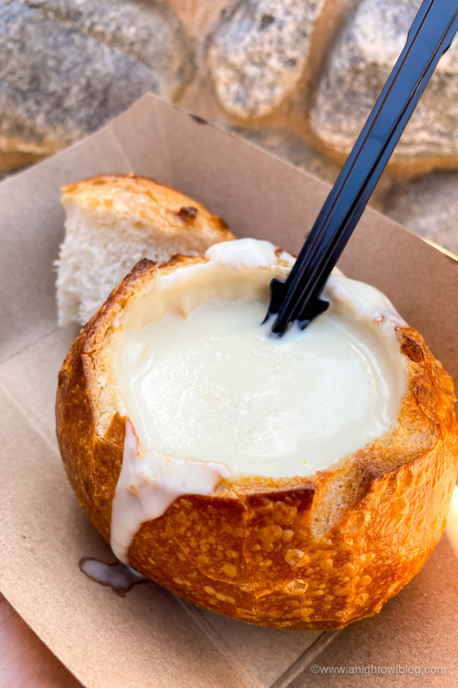 Fiscalini White Cheddar Lager Soup served in a Mini Boudin® Sourdough Bowl from Nuts About Cheese | From Mickey-Shaped Macarons to the Carbonara Garlic Mac & Cheese, there are so many great bites and brews to discover at the Disney California Adventure Food and Wine Festival!