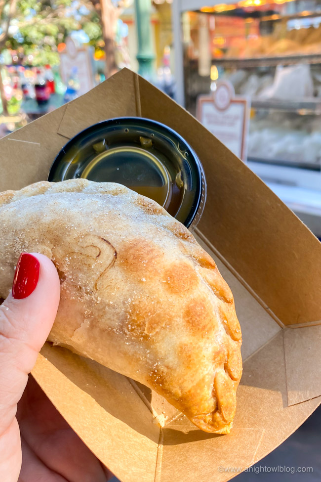 Sweet Empanada with Caramel Sauce from Festival Carts | From Mickey-Shaped Macarons to the Carbonara Garlic Mac & Cheese, there are so many great bites and brews to discover at the Disney California Adventure Food and Wine Festival!