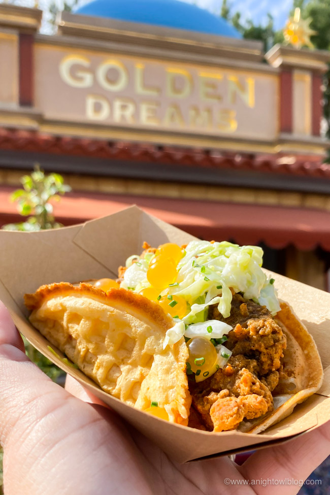 Brunch Fried Chicken & Waffle Sandwich from Golden Dreams | From Mickey-Shaped Macarons to the Carbonara Garlic Mac & Cheese, there are so many great bites and brews to discover at the Disney California Adventure Food and Wine Festival!