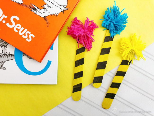 A perfect craft for Read Across America and Dr. Seuss celebrations, make these fun and easy Dr. Seuss Truffula Bookmarks.