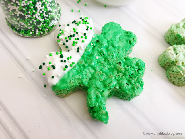 The perfect St. Patrick's Day snack, whip up these easy and adorable Green Shamrock Rice Krispie Treats!