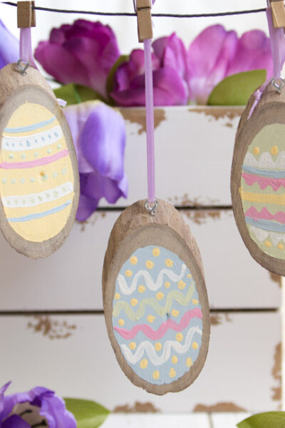 Perfect for Easter Decor, Easter Basket tags and more, create these adorable and easy Painted Wood Slice Easter Eggs in just minutes!