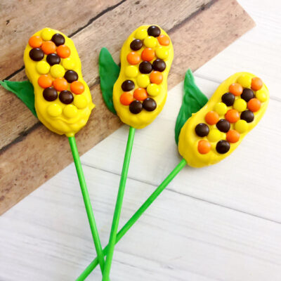 Perfect for Thanksgiving or fall parties, whip up these adorable Harvest Corn Cookie Pops in just a few easy steps!