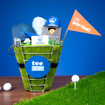 "Perfect for the golf lover in your life, whip up a ""Tee It Up"" Golf Gift Basket with Evite And Topgolf!"